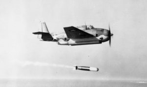 Aircraft flying above a torpedo it just launched