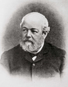 19th century portrait photograph of older man with balding head, light gray beard, and mustache
