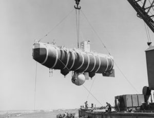 Trieste submersible suspended in air over water